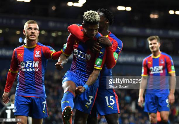 Patrick Van Aanholt of Crystal Palace celebrates after scoring his team's second goal during the Carabao Cup Third Round match between West Bromwich...