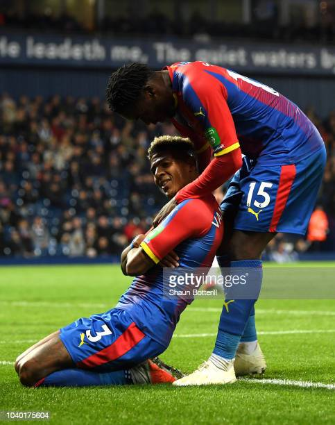 Patrick Van Aanholt of Crystal Palace celebrates after scoring his team's second goal with Jeffrey Schlupp of Crystal Palace during the Carabao Cup...