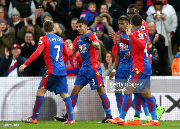 Patrick van Aanholt of Crystal Palace celebrates scoring his sides first goal with his Crystal Palace team mates during the Premier League match...
