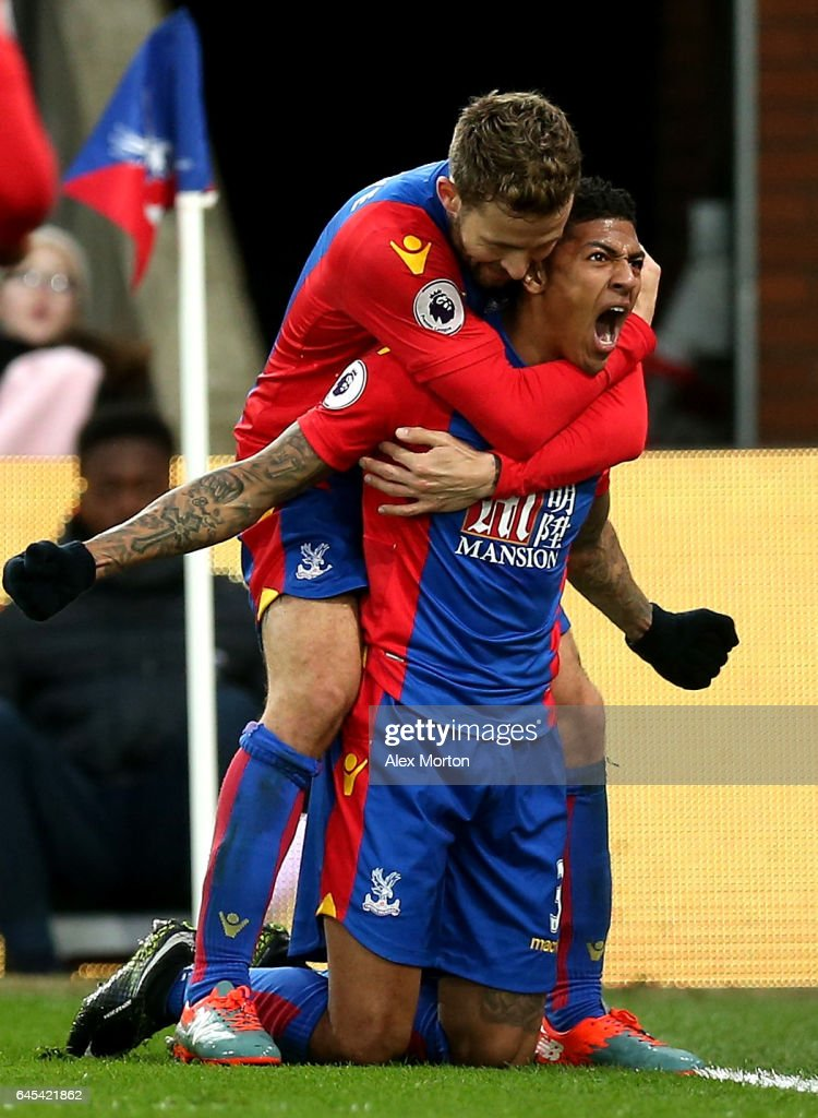 Patrick van Aanholt of Crystal Palace (R) celebrates scoring his sides first goal with Yohan Cabaye of Crystal Palace (L) during the Premier League match between Crystal Palace and Middlesbrough at Selhurst Park on February 25, 2017 in London, England.
