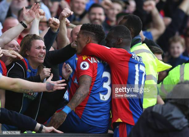 Patrick van Aanholt of Crystal Palace celebrates scoring his sides fourth goal with Christian Benteke of Crystal Palace and the Crystal Palace fans...