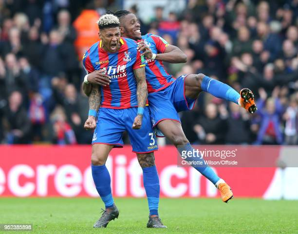 Patrick van Aanholt of Crystal Palace celebrates scoring their 4th goal as Wilfried Zaha of Crystal Palace jumps on his back during the Premier...