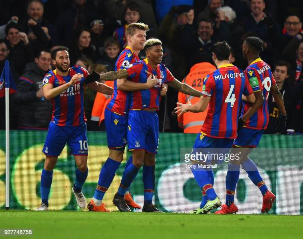 Patrick van Aanholt of Crystal Palace celebrates scoring their second goal during the Premier League match between Crystal Palace and Manchester...