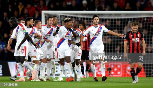 Patrick Van Aanholt of Crystal Palace celebrates with his teammates after he scores his sides first goal during the Premier League match between AFC...