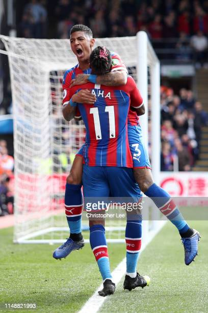 Patrick van Aanholt of Crystal Palace celebrates with team mate Wilfried Zaha of Crystal Palace after scoring their team's fourth goal during the...