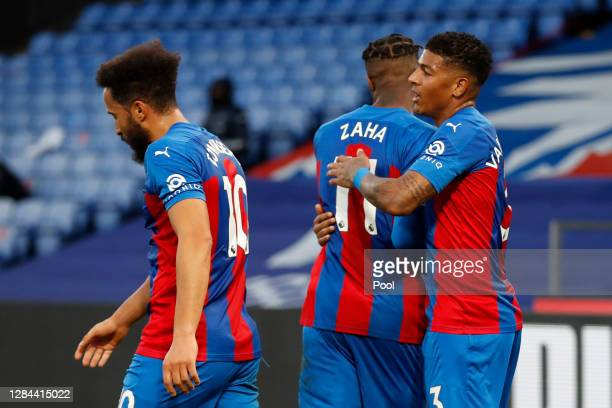 Patrick van Aanholt of Crystal Palace celebrates with teammate Andros Townsend and Wilfried Zaha after his cross is deflected in by Helder Costa of...