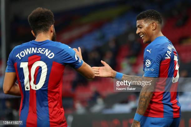Patrick van Aanholt of Crystal Palace celebrates with teammate Andros Townsend and after his cross is deflected in by Helder Costa of Leeds United...
