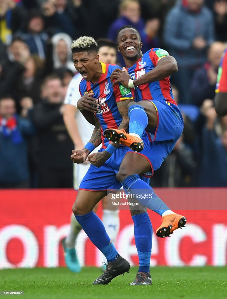 Patrick van Aanholt of Crystal Palace celebrates with Wilfried Zaha after scoring his sides fourth goal during the Premier League match between Crystal Palace and Leicester City at Selhurst Park on April 28, 2018 in London, England.