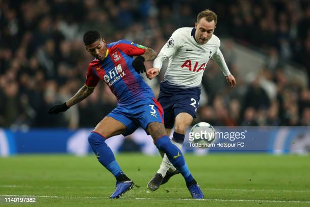 Patrick Van Aanholt of Crystal Palace challenges for the ball with Christian Eriksen of Tottenham Hotspur during the Premier League match between...