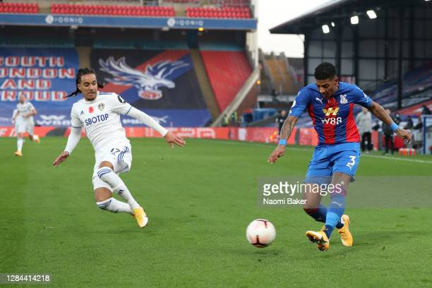 Patrick van Aanholt of Crystal Palace crosses the ball, before Helder Costa of Leeds United gets a touch, scoring an own goal, Crystal Palace's third...