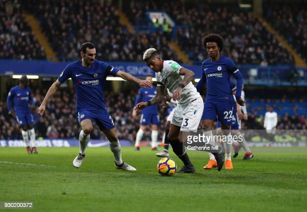 Patrick van Aanholt of Crystal Palace holds off Davide Zappacosta and Willian of Chelsea during the Premier League match between Chelsea and Crystal...