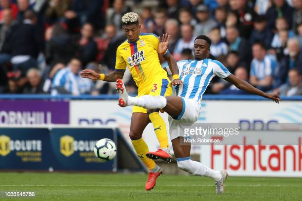 Patrick Van Aanholt of Crystal Palace is challenged by Adama Diakhaby of Huddersfield Town during the Premier League match between Huddersfield Town...
