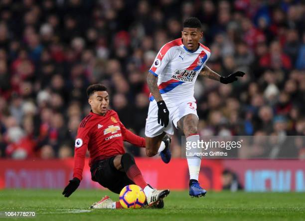 Patrick Van Aanholt of Crystal Palace is challenged by Jesse Lingard of Manchester United during the Premier League match between Manchester United...