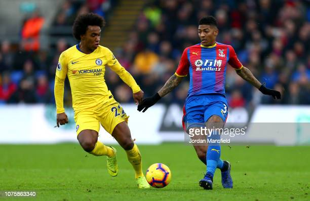 Patrick Van Aanholt of Crystal Palace is challenged by Willian of Chelsea during the Premier League match between Crystal Palace and Chelsea FC at...