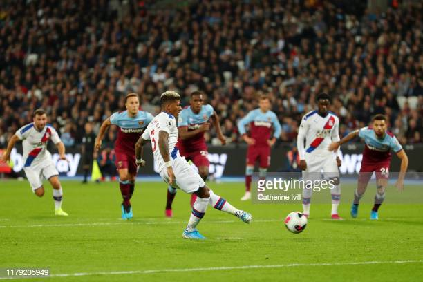 Patrick van Aanholt of Crystal Palace scores his sides first goal from the penalty spot during the Premier League match between West Ham United and...