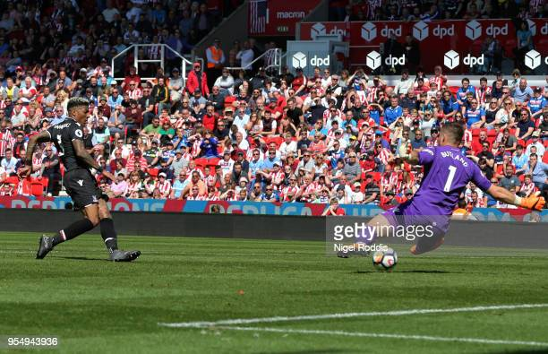 Patrick van Aanholt of Crystal Palace scores his sides second goal pas Jack Butland of Stoke City during the Premier League match between Stoke City...