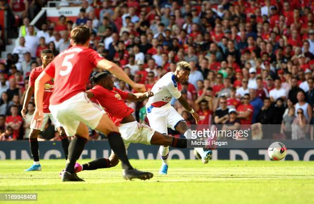 Patrick van Aanholt of Crystal Palace scores his team's second goal during the Premier League match between Manchester United and Crystal Palace at...