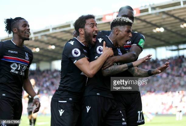 Patrick van Aanholt of Crystal Palcace celebrates scoring his side's second goal with team mates Andros Townsend and Christian Benteke during the...