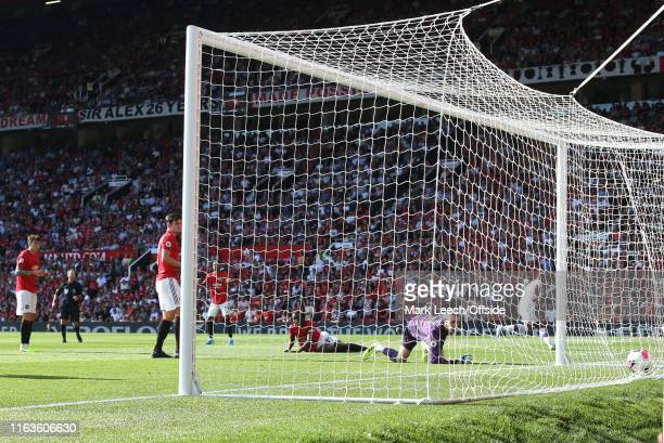 Patrick van Aanholt of Palace scores the winning goal during the Premier League match between Manchester United and Crystal Palace at Old Trafford on...