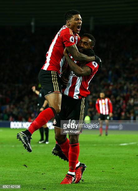 Patrick van Aanholt of Sunderland celebrates scoring his sides first goal with Jermain Defoe of Sunderland during the Premier League match between...