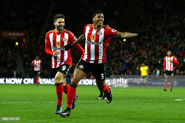 Patrick van Aanholt of Sunderland celebrates scoring his sides first goal with Fabio Borini of Sunderland during the Premier League match between...