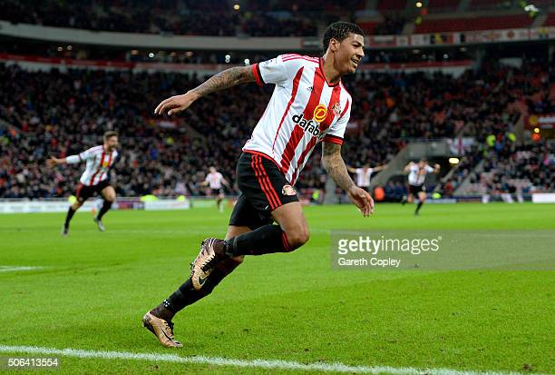 Patrick van Aanholt of Sunderland celebrates scoring his team's first goal during the Barclays Premier League match between Sunderland and A.F.C....