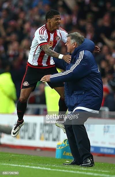 Patrick van Aanholt of Sunderland celebrates scoring his team's opening goal with manager Sam Allardyce during the Barclays Premier League match...