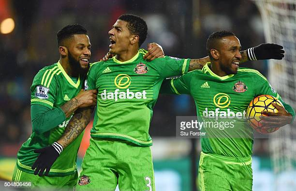 Patrick van Aanholt of Sunderland celebrates scoring his team's second goal with his team mates Jeremain Lens and Jermain Defoe during the Barclays...