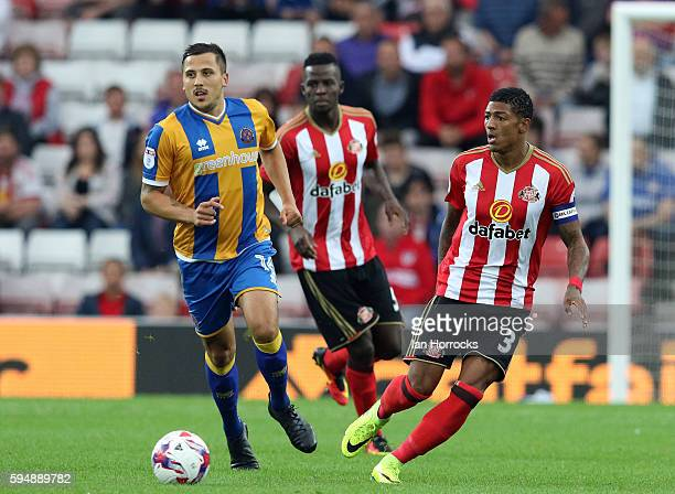 Patrick Van Aanholt of Sunderland clears the ball from Antoni Sarcevic of Shrewsbury during the EFL Cup second round match between Sunderland AFC and...