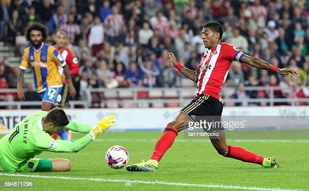 Patrick Van Aanholt of Sunderland has his shot saved by Shrewsbury keeper Jayson Leutwiler during the EFL Cup second round match between Sunderland...