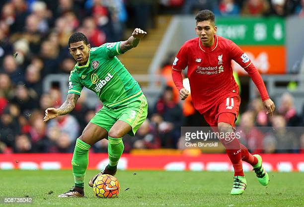 Patrick van Aanholt of Sunderland is watched by Roberto Firmino of Liverpool during the Barclays Premier League match between Liverpool and...