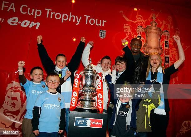 Patrick Vieira and kids pose with the FA Trophy during the FA Cup Trophy Tour at City of Manchester Stadium on February 10, 2010 in Manchester,...
