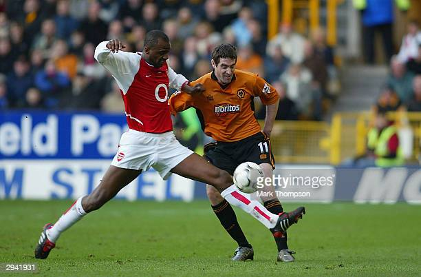 Patrick Vieira captain of Arsenal tackles Mark Kennedy of Wolves during the FA Barclaycard Premiership match between Wolverhampton Wanderers and...