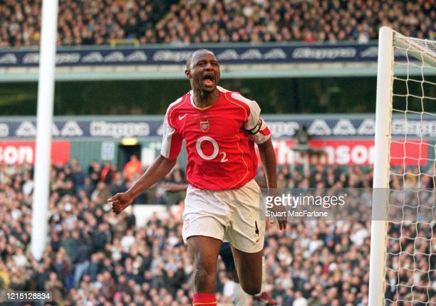 Patrick Vieira celebrates scoring a goal for Arsenal during the Premier League match between Tottenham Hotspur and Arsenal on November 13, 2004 in...