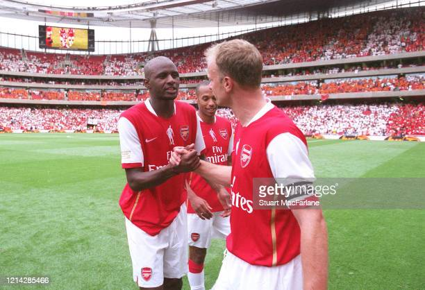 Patrick Vieira ex Arsenal shakes hands with Dennis Bergkamp ex Arsenal after the Dennis Bergkamp Testimonial between Arsenal XI and Ajax XI on July...