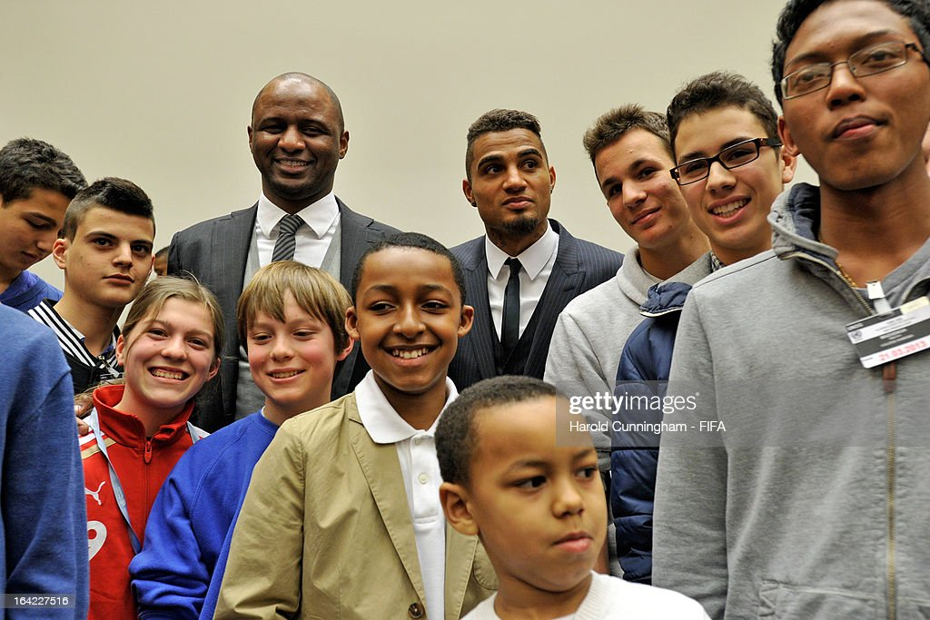 Patrick Vieira (L), Football Development Executive at Manchester City Football Club, and Kevin-Prince Boateng (R) of AC Milan and Ghana, pose with children after the discussion panel on the International Day for the Elimination of Racial Discrimination at United Nations Office in Geneva on March 21, 2013 in Geneva, Switzerland. On the United Nations' (UN) International Day for the Elimination of Racial Discrimination, the Office of the High Commissioner for Human Rights (OHCHR) see today as a unique opportunity to celebrate diversity and urged all sportswomen and sportsmen, sports authorities and fans to take decisive action against intolerance and racism in sports and celebrate human achievement and excellence beyond the narrow boundaries of ethnicity, race or nationality.