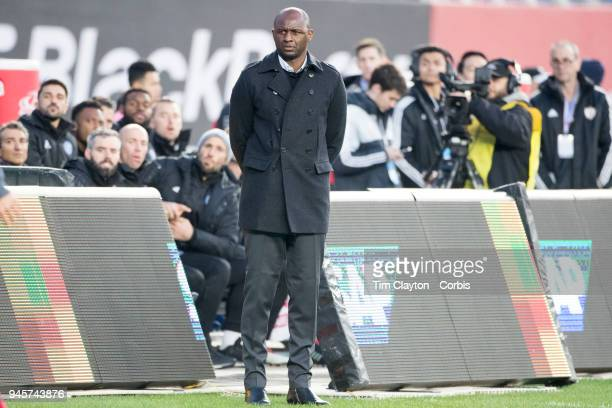 Patrick Vieira head coach of New York City FC on the sideline and David Villa of New York City on the substitutes bench watch the action during the...