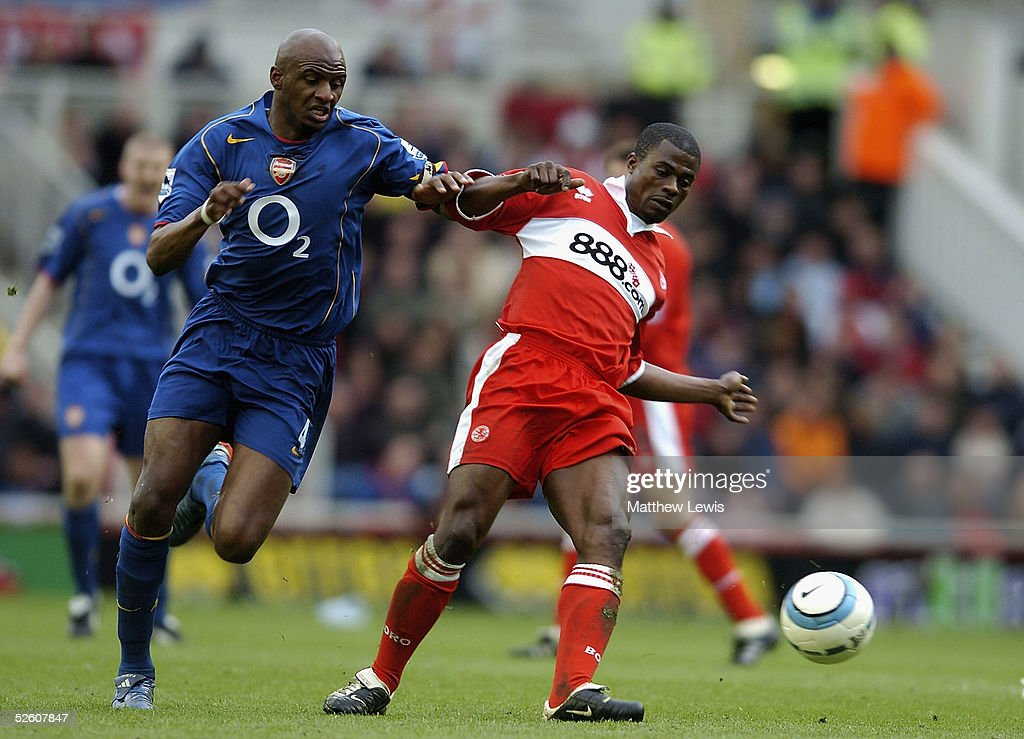 Patrick Vieira of arsenal and George Boateng of Middlesbrough challenge for the ball during the Barclays Premiership match between Middlesbrough and Arsenal at the Riverside Stadium on April 9, 2005 in Middlesbrough, England.
