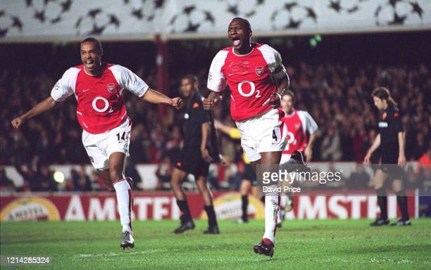 Patrick Vieira of Arsenal celebrates after scoring the first goal with Thierry Henry during the UEFA Champions League Phase 2 Group B match between...