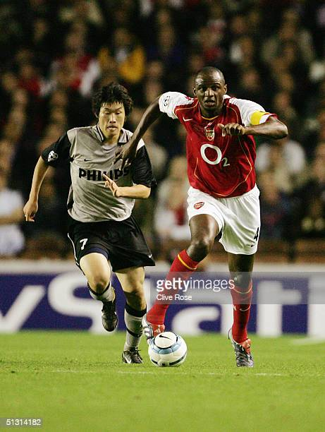 Patrick Vieira of Arsenal chased by JiSung Park of PSV Eindhoven during the UEFA Champions League Group E match between Arsenal and PSV Eindhoven at...
