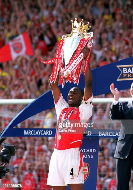 Patrick Vieira of Arsenal lifts the Premier League Trophy after the Premier League match between Arsenal and Leincester City on May 15 2004 in London...