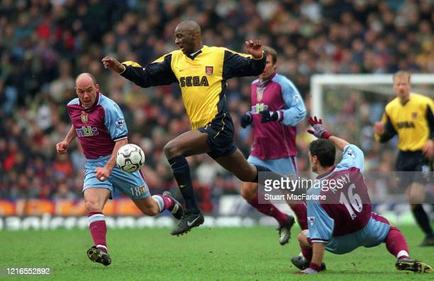 Patrick Vieira of Arsenal takes on Steve Stone and Alpay of Villa during the Premier League match between Aston Villa and Arsenal on March 18 2002 in...