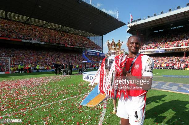 Patrick Vieira of Arsenal with Premier League Trophy after the Premier League match between Arsenal and Leicester City on May 15 2004 Arsenal Stadium...