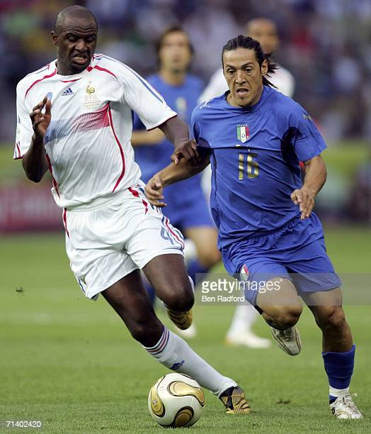 Patrick Vieira of France and Mauro Camoranesi of Italy battle for the ball during the FIFA World Cup Germany 2006 Final match between Italy and...