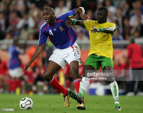 Patrick Vieira of France and Moustapha Salifou of Togo battle for the ball during the FIFA World Cup Germany 2006 Group G match between Togo and...