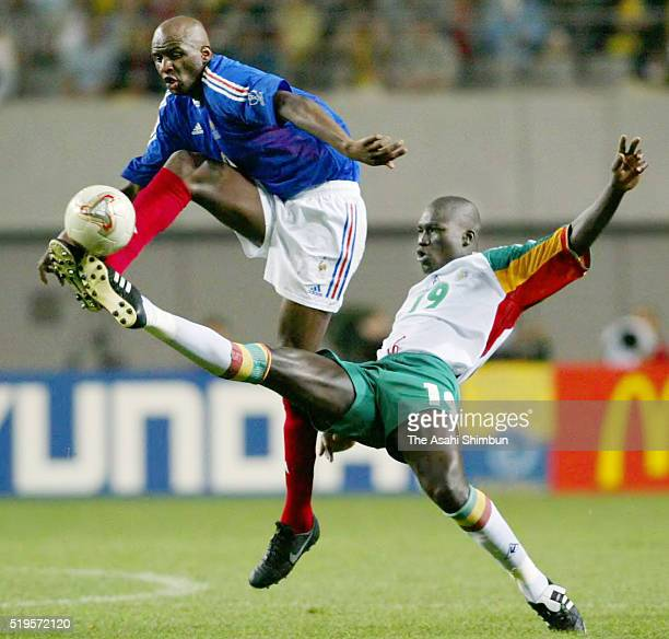 Patrick Vieira of France and Papa Bouba Diop of Senegal compete for the ball during the FIFA World Cup Korea/Japan Group A match between France and...