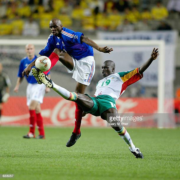 Patrick Vieira of France challenges for the ball with Papa Bouba Diop of Senegal during the second half of the France v Senegal Group A World Cup...
