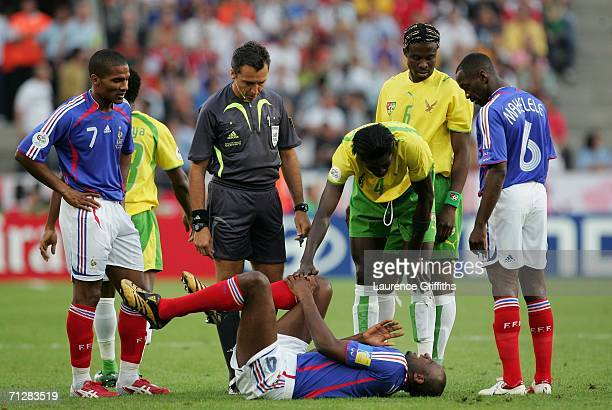 Patrick Vieira of France grabs his leg in pain during the FIFA World Cup Germany 2006 Group G match between Togo and France at the Stadium Cologne on...