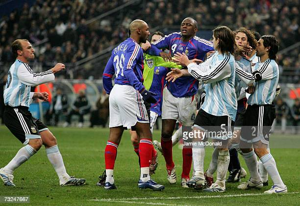 Patrick Vieira of France trys to break up a fight between Nicolas Anelka and some Argentinan players during the International friendly match between...