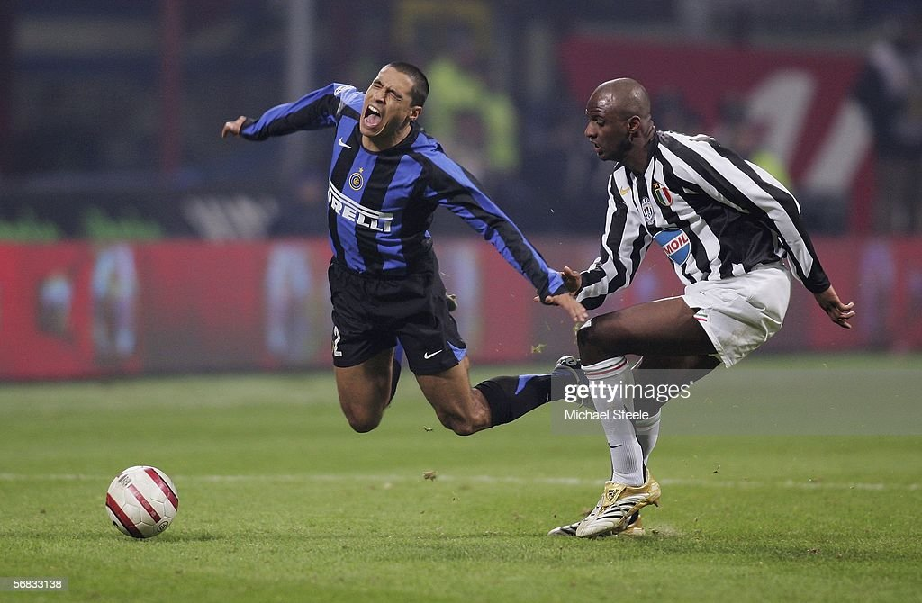 Patrick Vieira (right) of Juventus fouls Ivan Cordoba of Inter during the Serie A match between Inter Milan and Juventus at the Stadio San Siro on February 12, 2006 in Milan, Italy.